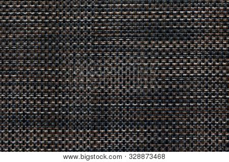 Weaving Pattern Of Interwoven Fibers. Fiber Braided Background. Close-up Of Black And Orange Synthet