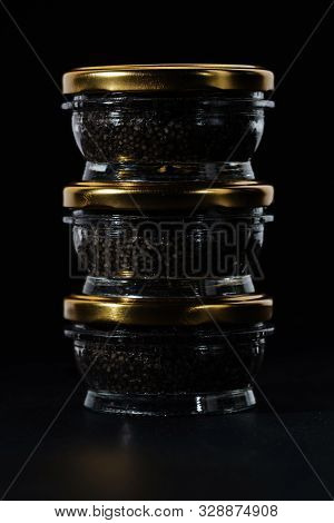 Glass Jars With Black Sturgeon Caviar. Black Sturgeon Caviar. Luxurious Black Caviar.