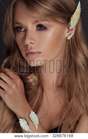 Beautiful Woman With Perfect Make Up And Hairstyle Posing In Studio In White Jewellry Set Like Angel