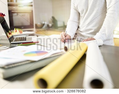 Close-up Shot Of A Young Asian Male Designer Drawing On Drafting Paper