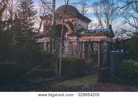 Old Monument With Dome And Pillars In A Park