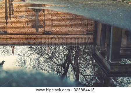 Reflection Of A Cross In A Puddle