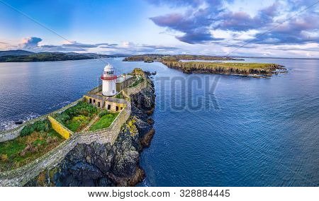 Aerial Of The Rotten Island Lighthouse With Killybegs In Background - County Donegal - Ireland