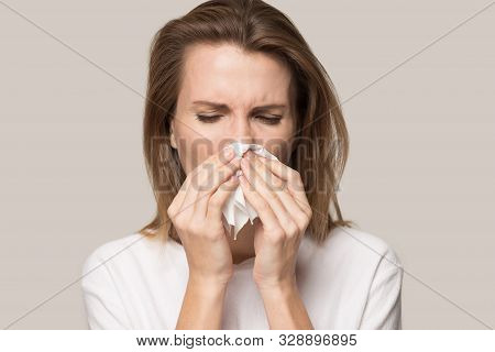 Sick Young Woman Use Tissue Blowing Runny Nose