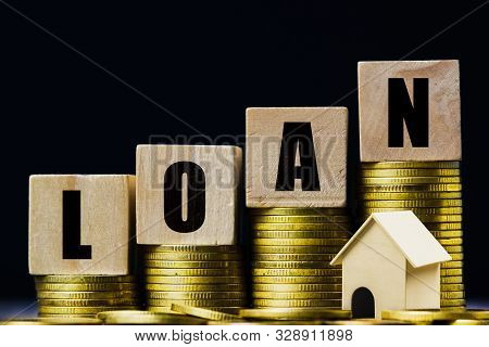 Saving Money, Home Loan, Mortgage, A Property Investment For Future Concept. A Wooden Block On Stack
