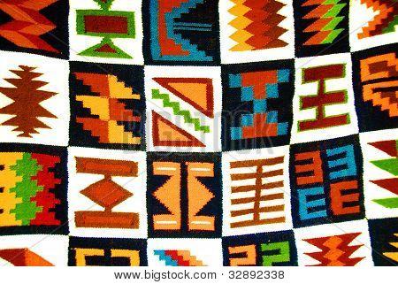 Artistic desing on peruvian carpet in bazaar