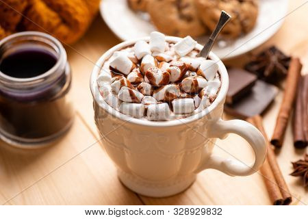 Cup Of Hot Chocolate With Marshmallows, Chocolate Sauce And Cinnamon. Cozy Warm Drink, Comfort Food