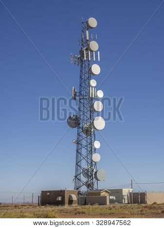 Communication And Cell Phone Tower On Blue Sky In Desert