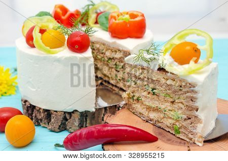 Appetizing Cake With Chicken Meat, Eggs And Salad. Snack Cake. Wooden Board With Hot Peppers And Tom