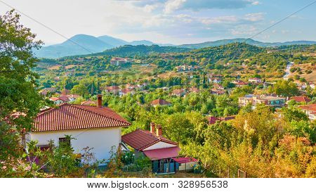 Panoramic rural landscape with village and valley in the evening, Kastraki village, Thessaly, Greece -  Picturesque greek scenery