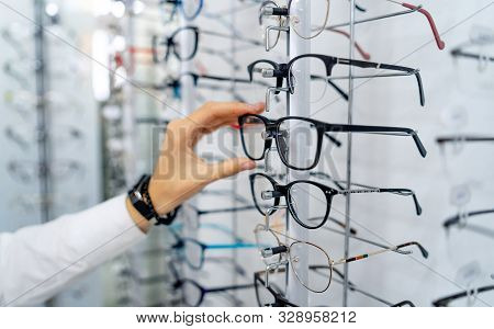 Row Of Glasses At An Opticians. Eyeglasses Shop. Stand With Glasses In The Store Of Optics. Womans H