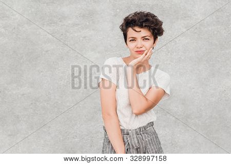 Charming Young Woman With Creative Hairstyle Is Posing With Disappointed Incredulous Face. Emotions