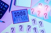 Handwriting text Ddos Attack. Concept meaning perpetrator seeks to make network resource unavailable Mathematics stuff and writing equipment above pastel colours background. poster