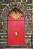Gothic style red entrance doors of the Episcopal church in Vineland New Jersey poster