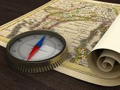 Old Map and Compass on the table poster