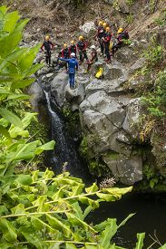 Sao Miguel Island, Azores - June 26, 2019: Instructor And A Group Of Old And Young People Canyoning