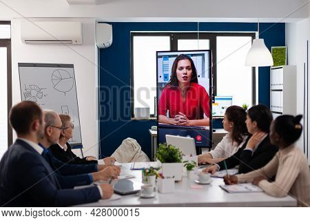 Diverse Team Of Coworkers Talking With Project Manager Using Webcam During Business Conference Sitti