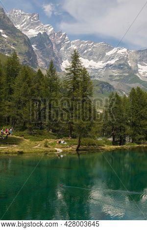Summer Alpine Landscape With The Matterhorn (cervino) Reflected On The Blue Lake (lago Blu) Near Bre