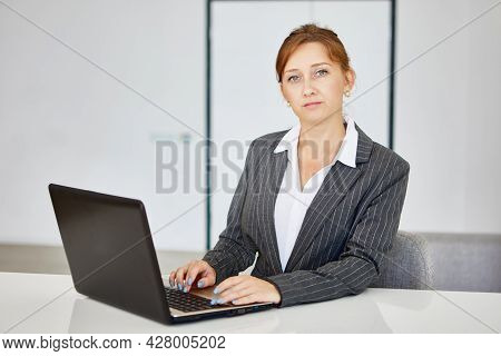 Manager Works Using Laptop During Telework In Working Cabinet.