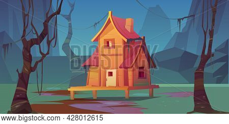 Wooden Stilt House In Summer Forest. Old Shack With Terrace On Piles In Sunny Wood With Green Trees