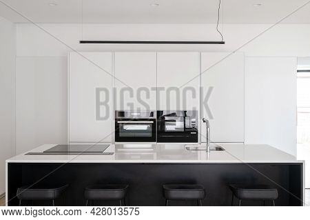 Modern Kitchen Interior With Built In Equipment, Glossy Counter With Electrical Induction Stove Top