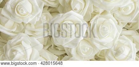 Banner With Background Of White Fake Flowers. Artificial White Foamirane Roses.