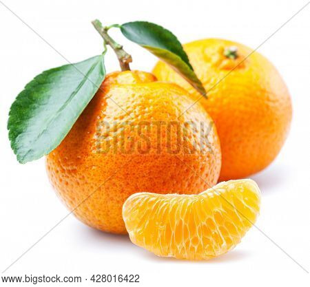 Ripe tangerine fruits with slices and tangerine leaves isolated on white background.