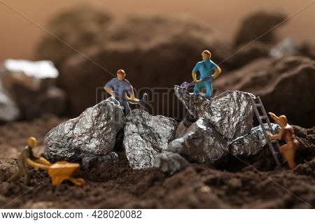 Mining Of Cobalt, Lithium. Miniature Worker Mining Metal Zinc And Silver. Mining Business, Mineral R