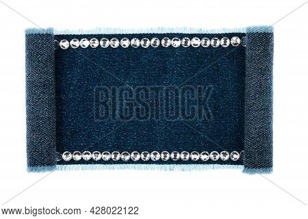 Denim Sign Embellished With Silver Rhinestones With Curled Edges. Isolated On White Background.