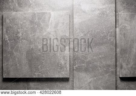 Abstract grey background texture at table or wall surface. Gray piece of chipboard at table background surface