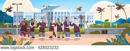 Arab Graduated Students Standing Together Near University Building Arabic Graduates Celebrating Acad