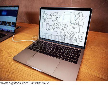 Paris, France - Sep 22, 2017: New Apple Macbook Pro Professional Laptop With Motion Wallpaper Inside
