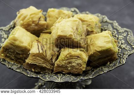 Tasty Sweet Baklava. Turkish Ramadan Dessert Baklava On A Decorative Plate. Baklava With Nuts And Ho