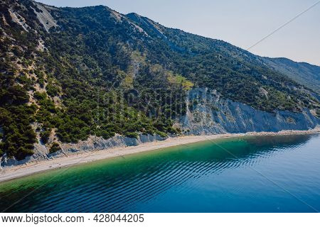 Coastline With Sea And Highest Cliff With Trees. Summer Day On Sea. Aerial View