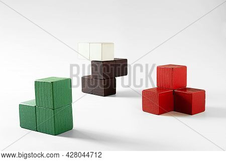 Red, Brown, White And Green Glued Wooden Cubes For The Development Of Logical Thinking In Young Chil