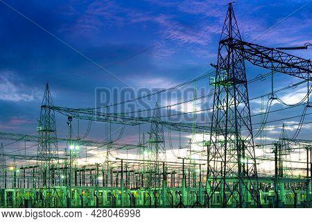 Illuminated Electric Substation Plant In Latin America At Night