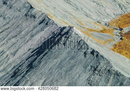 Minimal Autumn Landscape With Gray Rocky Pointy Peak In Sunshine. Spectacular Scenic View From Above