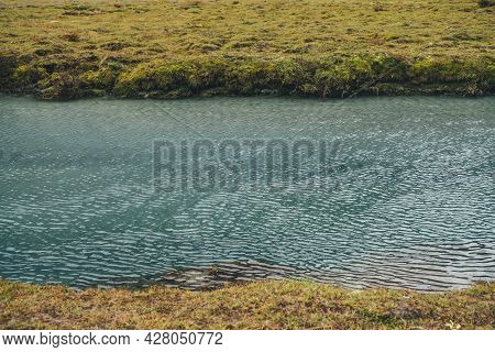 Minimalist Autumn Landscape With Mountain Creek Among Yellow Grass. Minimal Nature Background With R