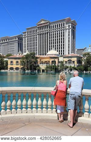 Las Vegas, Usa - April 14, 2014: Tourists Visit Caesars Palace View In Las Vegas. Both Hotels Are Am