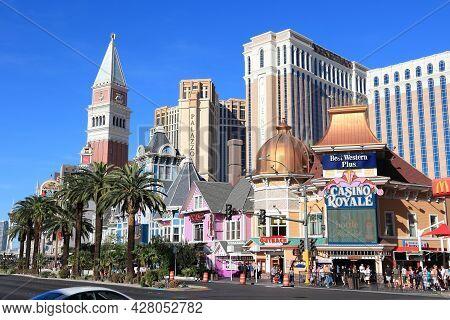 Las Vegas, Usa - April 14, 2014: People Visit The Famous Strip In Las Vegas. 15 Of 25 Largest Hotels