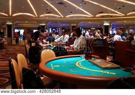 Las Vegas, Usa - April 14, 2014: People Visit Caesar's Palace Casino Resort In Las Vegas. The Famous