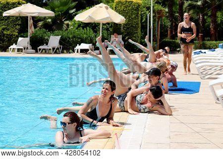 Marmaris, Turkey - July 2021: Women Doing Aqua Aerobics In A Swimming Pool. Water Sport, Vacation An