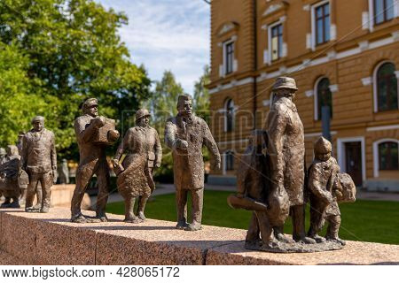 View Of The Ajan Kulku Bronze Statues Commemorating The City History Of Oulu In The Park In Front Of