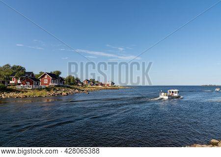Fishing Boat Leaves The Small Idyllic Harbor Of Ohtakari In The Bothnian Bay On The Finnish Coast