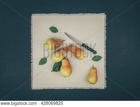 Pears. Collecting Pears. Fresh Ripe Pears On A Wooden Table. Pear Autumn Harvest. The Concept Of Aut