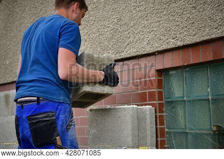 The Mason Masonry A Wall Of Concrete Blocks On The House