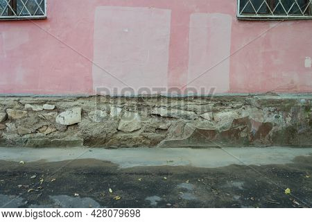 Foundation Arrangement In An Old House. The Old Foundation Consists Of Large Stones And Concrete. Ba