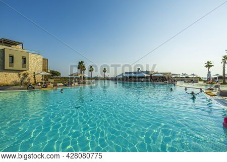 View Of Exterior Of Portes Lithos Luxury Resort Hotel Building With Swimming Pool. Greece. Nea Potid