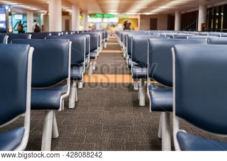 New Normal In Covid-19 Pandemic. Empty Customer Seat In Airport Social Distance With Symbol Placed O