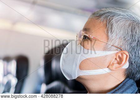 Elderly Asian Female Passenger Wear Face Mask On Aircraft While Protect Coronavirus Epidemic Stopped